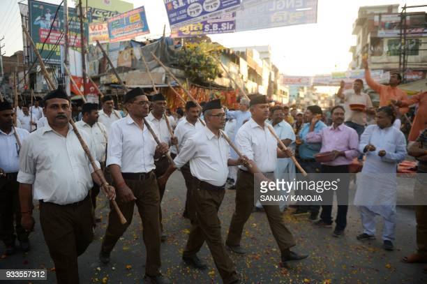 Indian Hindu Rashtriya Swayamsevak Sangh volunteers march along a road during an event to mark the Hindu New Year in Allahabad on March 18 2018 The...