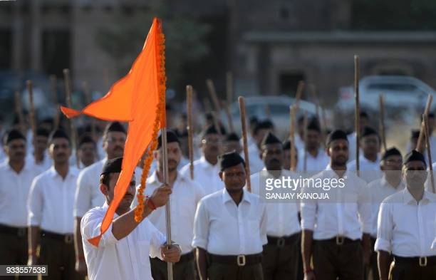 Indian Hindu Rashtriya Swayamsevak Sangh volunteers march during an event to mark the Hindu New Year in Allahabad on March 18 2018 The Rashtriya...
