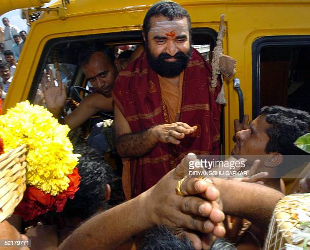 Indian Hindu religious leader Vijayendra Saraswathi gestures as he greets his followers after leaving The Central Prison in Madras 11 February 2005...