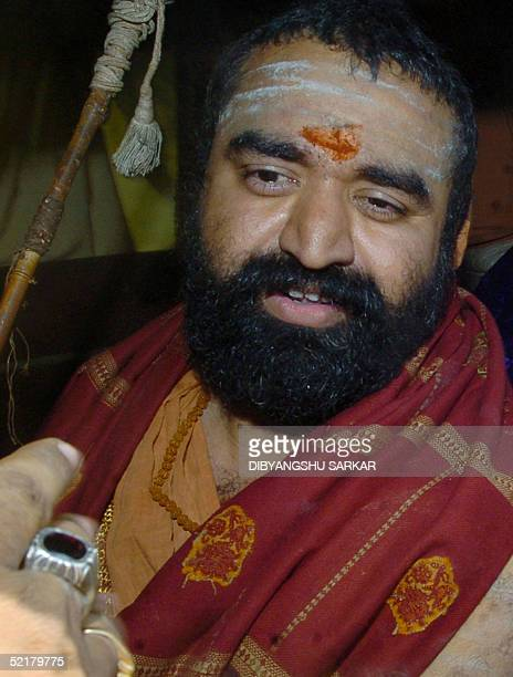 Indian Hindu religious leader Vijayendra Saraswathi looks towards his unseen followers after leaving The Central Prison in Madras 11 February 2005...