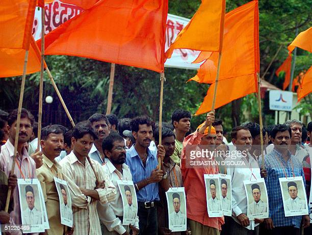 Indian Hindu rightwing Shiv Sena party workerswearing portraits of freedom fighter Savarkar wave saffron flags at an agitation 'Jode Mara' against...