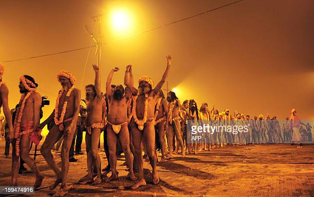 Indian Hindu Sadhus or holy men line up as they join a procession that will take them to the waters of the Sangham or the confluence of the the...