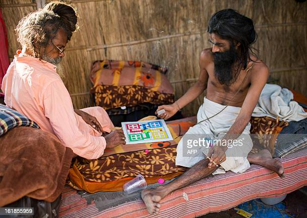 Indian Hindu sadhus play a board game on February 17 2013 during the Kumbh Mela festival in Allahabad The Kumbh Mela in the town of Allahabad will...