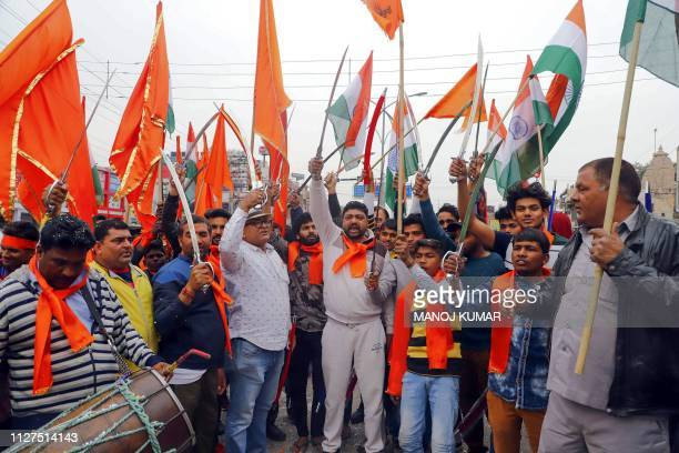 Indian Hindu Sena organisation members shout antiPakistani slogans as they celebrate the Indian Air Force strike launched on a JaisheMohammad camp in...