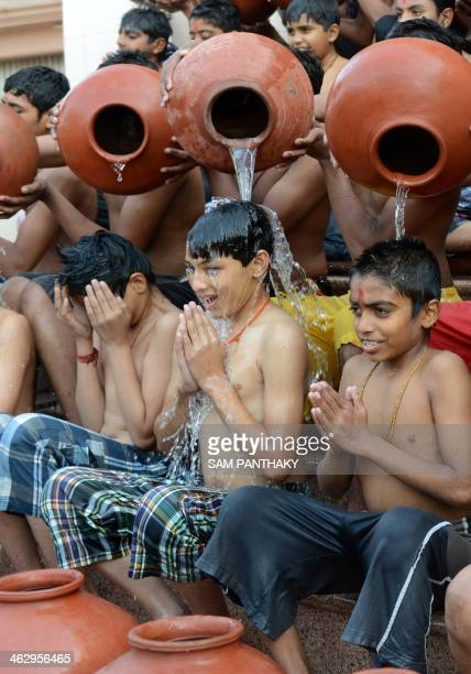 Indian Hindu students from the Swaminarayan Gurukul participate in the 'Magh Snan' or 'Holy Bath' in Ahmedabad on January 16 2014 Students of...
