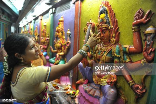 Indian Hindu woman offer prayers to the Hindu Goddess Lakshmi also known as 'Varalakshmi Vratham' at a temple in Hyderabad on August 4 2017 The...
