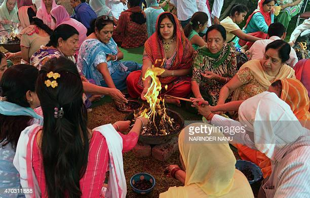 Indian Hindus devotees perform a 'Hawan' or religious ritual for world peace during a Srimad Bhagavad Gita Path event in Amritsar on April 19 2015...