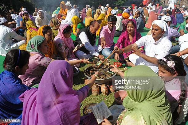Indian Hindus devotees perform a 'Hawan' or religious ritual for world peace during a religious function by the Srimad Bhagavad Gita Path in Amritsar...