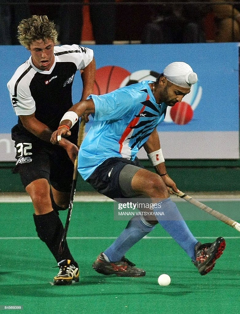 Indian hockey captain Sandeep Singh vies for the ball with New Zealand opponent Nick Wilson during the opening match of the fournation Hockey Gold...