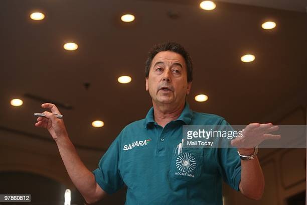 Indian Hockey Coach Jose Brasa gestures at a press conference where he presents a series of proposals for betterment of Indian hockey in New Delhi on...