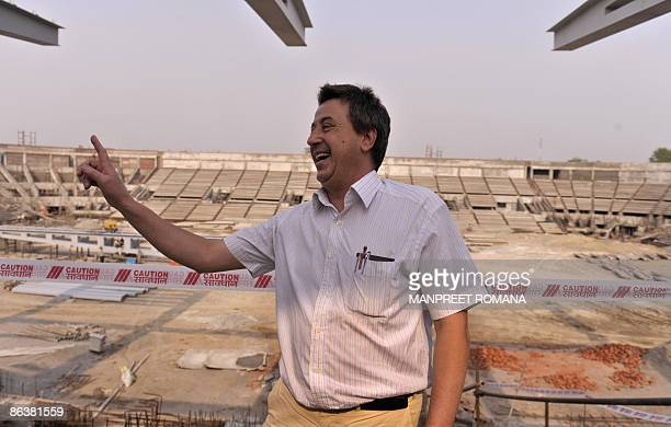 Indian hockey coach Jose Brasa gestures during his visit to the Dhyan Chand National Stadium to inspect the ongoing work for the 2010 commonwealth...
