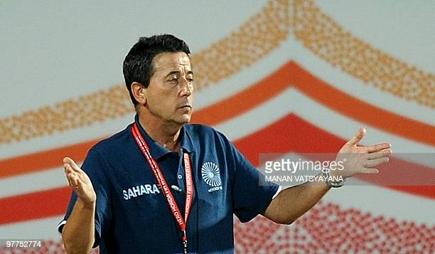 Indian hockey coach Jose Brasa gestures during the World Cup 2010 Classification match against Argentina at the Major Dhyan Chand Stadium in New...