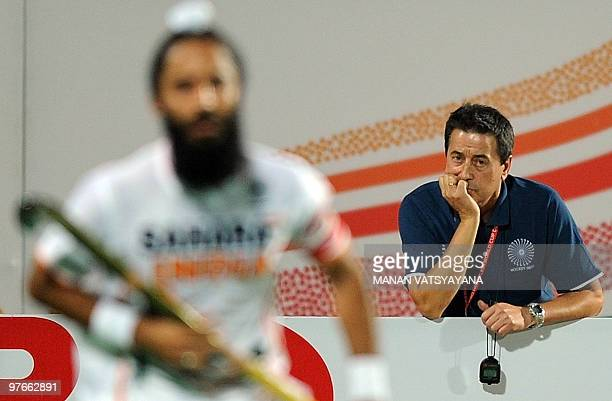 Indian hockey coach Jose Brasa looks on during the World Cup 2010 Classification match against Argentina at the Major Dhyan Chand Stadium in New...
