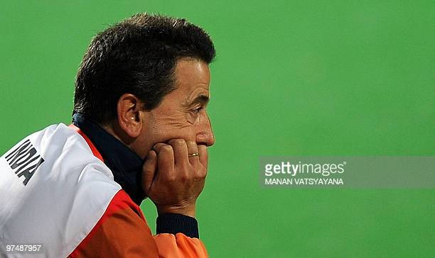Indian hockey coach Jose Brasa looks on following the loss to England during their World Cup 2010 match at the Major Dhyan Chand Stadium in New Delhi...