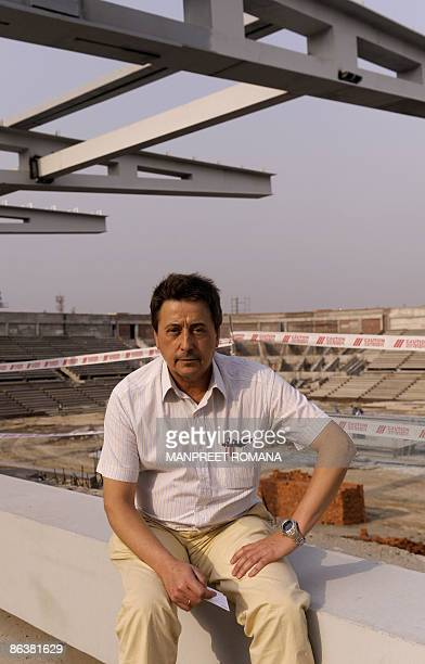 Indian hockey coach Jose Brasa poses during his visit to the Dhyan Chand National Stadium to inspect the ongoing work for the 2010 commonwealth games...