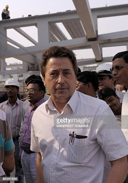 Indian hockey coach Jose Brasa smiles during his visit to the Dhyan Chand National Stadium to inspect the ongoing work for the 2010 commonwealth...