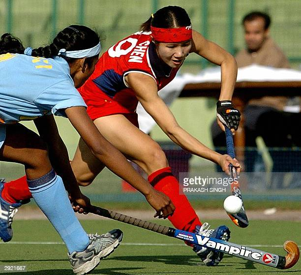 Indian hockey player Kanti Baa tackles China's Chen Qui Qi during a league match of the 5th Women's Asia Hockey Cup in New Delhi 02 February 2004...