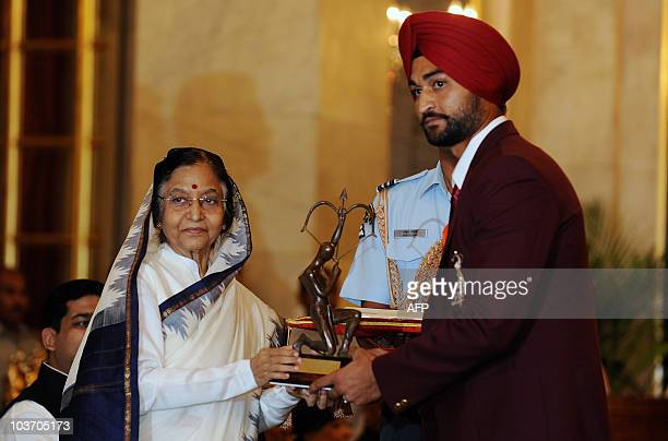 Indian hockey player Sandeep Singh receives The Arjuna Award 2010 from Indian President Pratiba Patil during a function at The Presidential Palace in...