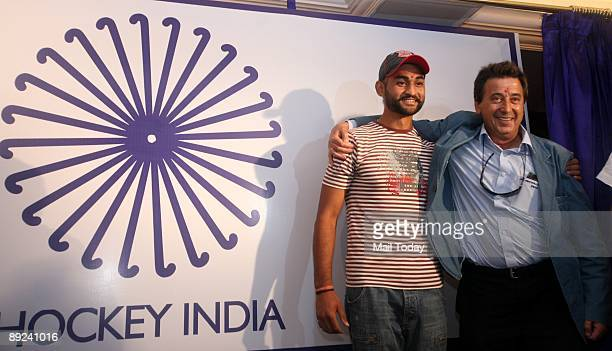 Indian hockey team captain Sandeep Singh and coach Jose Brasa pose prior to the unveiling of the new team logo in New Delhi on Thursday July 23 2009...