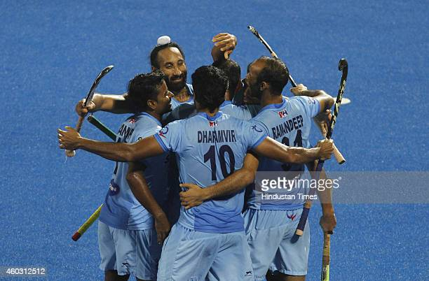 Indian Hockey team celebrates after winning their quarterfinal match of Hero Champions Trophy 2014 against Belgium at Kalinga Stadium on December 11...