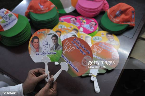 Indian holds election campaign fans theg Bharatiya Janata Party and Indian National Congress party ahead of the upcoming Telangana state legislative...