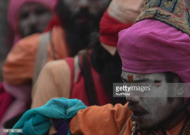 Indian holy men of Alakh Community ask for alms in various religious community camps during Kumbh Mela in Allahabad on January 23 2019 Lakhs of...