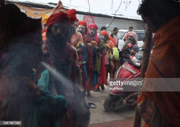 Indian holy men of Alakh Community asks for alms in various religious community camps during Kumbh Mela in Allahabad on January 23 2019 Lakhs of...