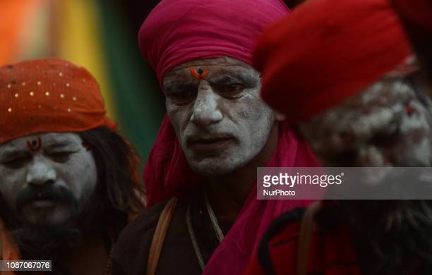 indian holy men of Alakh Community dreses up before going out to ask alms in various religious community camps during Kumbh Mela in Allahabad on...