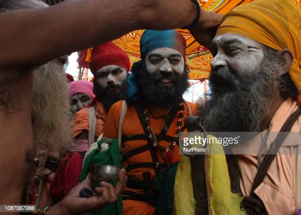 Indian holy men of Alakh Community dress up before going out to ask for alms in various religious community camps during Kumbh Mela in Allahabad on...