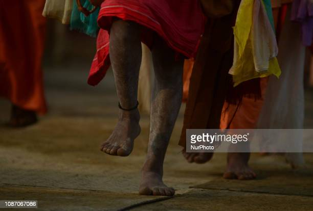 Indian holy men of Alakh Community walk out to ask alms in various religious community camps during Kumbh Mela in Allahabad on January 23 2019 Lakhs...