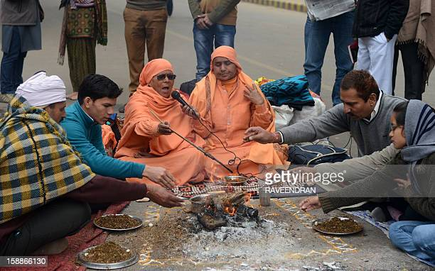 Indian holy women and demonstrators perform a prayer ritual in memory of a gangrape victim in New Delhi on January 2 2013 The family of an Indian...