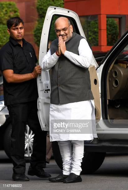 Indian Home Minister Amit Shah gestures as he arrives to attend a meeting with the newly-named cabinet in New Delhi on May 31, 2019. - As the...