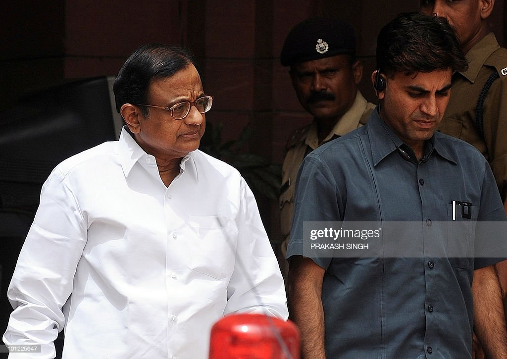 Indian Home Minister P. Chidambaram (L) leaves the home ministry in New Delhi on May 28, 2010. Chidambaram said he suspected sabotage behind the derailment of a Howrah-Mumbai train in West Bengal's West Midnapore district, though it was unclear whether explosives were used. Maoist rebels derailed a high-speed train packed with sleeping passengers into the path of a freight train in eastern India, killing at least 71 people, police said.AFP PHOTO/Prakash SINGH
