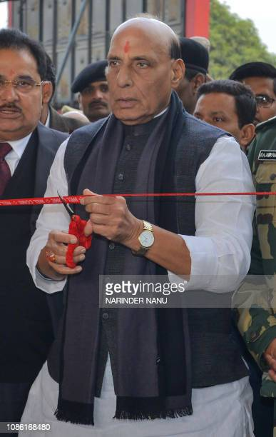 Indian Home Minister Rajnath Singh cuts the ribbon during the inauguration of the upgraded spectator gallery near the IndiaPakistan WagahAttari...
