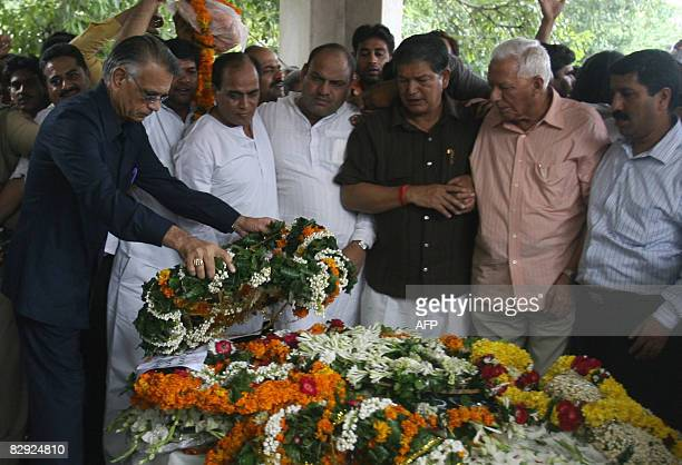 Indian Home Minister Shivraj Patil lays a wreath on the body of slain Indian police Inspector Mohan Chand Sharma during a funeral ceremony at a...