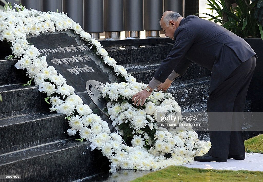Indian Home Minister Sushil Kumar Shinde lays a wreath at a memorial for those police and uniformed personnel who lost their lives in 2008 terror attacks in Mumbai on November 26, 2012.Pakistani-born Mohammed Ajmal Kasab, 25, the sole terrorist captured alive during the attack was hanged last week at a prison in western India for his role in what is India's deadliest terror attacks till date. A total of 166 people were killed and more than 300 others were injured when 10 heavily-armed Islamist militants stormed the city on November 26, 2008, attacking a number of sites, including the city's main railway station, two luxury hotels, a popular tourist restaurant and a Jewish centre.