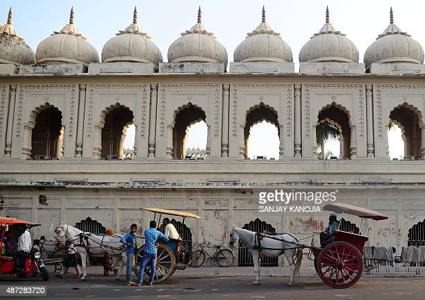 Indian horse cart owners wait for passangers outside the Bara Imambara in Lucknow on September 8 2015 AFP PHOTO/ SANJAY KANOJIA