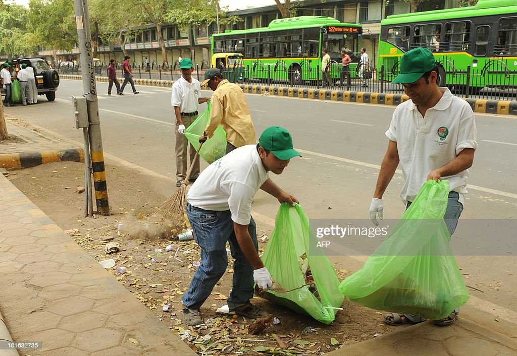 Indian hotel staff and volunteers pick up litter along a street during World Environment Day in New Delhi on June 5, 2010. This year the theme of World Environment Day 2010 is �Many Species. One Planet. One Future.� The theme reflects the important task of saving and conserving the different forms of life on earth.