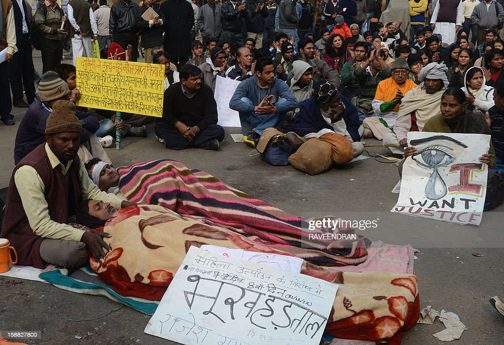 Indian hunger strikers (foreground) demonstrate following the death of a gang rape victim in New Delhi on December 31, 2012. The family of an Indian gang-rape victim said they would not rest until her killers are hanged as they spoke of their own pain and trauma over a crime that has united the country in grief.