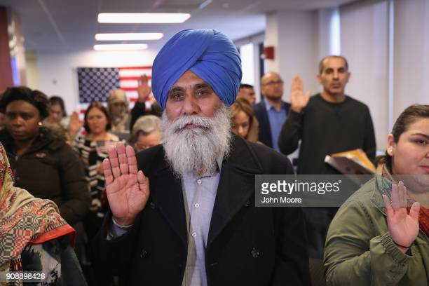 Indian immigrant Darshan Darshan takes the oath of allegiance to the United States at a naturalization ceremony on January 22 2018 in Newark New...