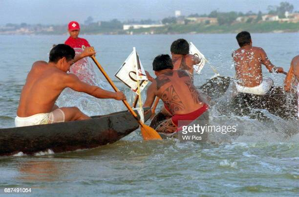 Indian in action at Tocantins river during indian olympic games in Maraba northern of Brazil