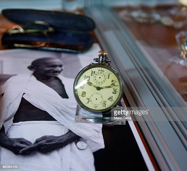 Indian independence leader Mahatma Gandhi's glasses and pocket watch are seen before a controversial auction of his memorabilia March 5 2009 in New...