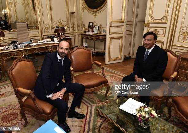 Indian industrialist Lakshmi Mittal head of ArcelorMittal poses with French Prime Minister Edouard Philippe ahead of a meeting at Hotel Matignon in...