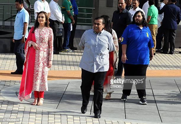 Indian industrialist Mukesh Ambani his wife Nita Ambani and son Anant Ambani walk during the inauguration of a youth football function in Mumbai on...