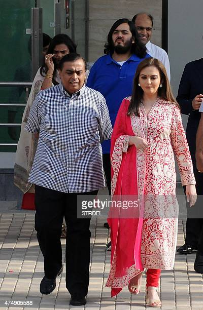 Indian industrialist Mukesh Ambani his wife Nita Ambani and their son Anant Ambani walk during the inauguration of a youth football function in...