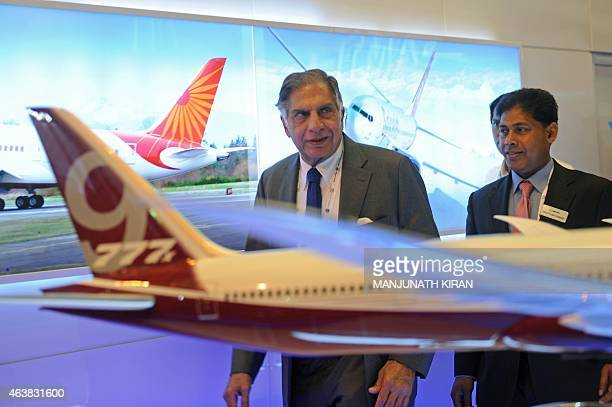 Indian industrialist Ratan Tata walks after a meeting with Boeing officials at their stall at Yelahanka Airforce Station in Bangalore on February 19...