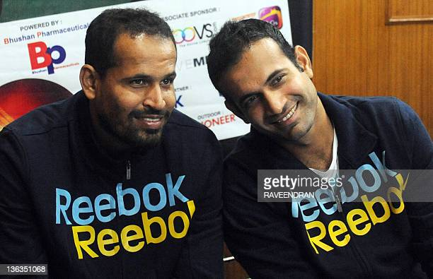 Indian international cricketers and brothers Irfan Pathan and Yusuf Pathan pose during a launch ceremony for Cricket Champs for kids in New Delhi on...
