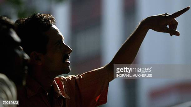 Indian investors watch share prices on the digital stock ticker outside the Bombay Stock Exchange building in Mumbai 16 January 2008 Indian share...