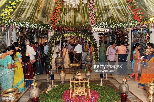 Indian Jain devotees visit the Devkinandan Jain Sangh on the occasion of Mahavir Janma Kalyanak Vachan in Ahmedabad on August 20 2009 Precious...