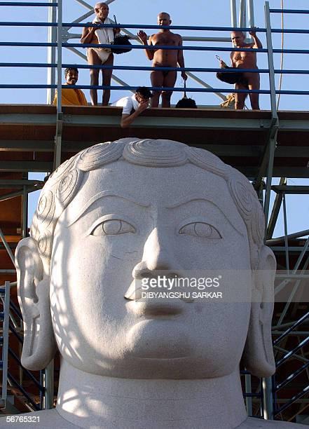 Indian Jain Sadhus pray at the 588 foot monolith of Gomateshwara on the Vindhyagiri hill in Shravanabelagola around 160 km west of Bangalore 07...
